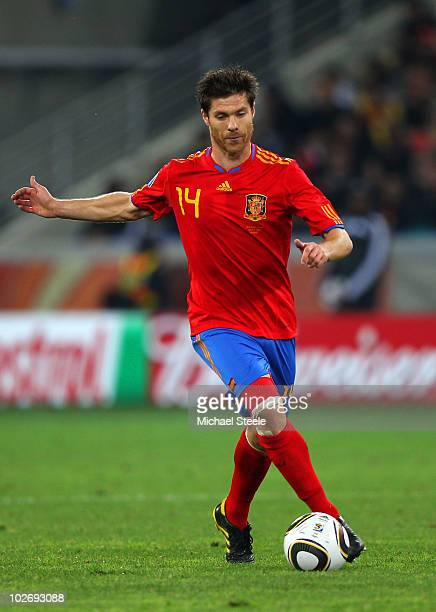 Xabi Alonso of Spain runs with the ball during the 2010 FIFA World Cup South Africa Semi Final match between Germany and Spain at Durban Stadium on...