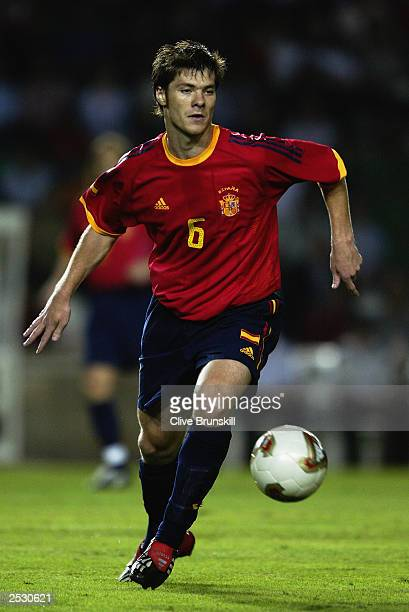 Xabi Alonso of Spain runs with the ball during the UEFA European Championships 2004 Group 6 Qualifying match between Spain and Ukraine held on...