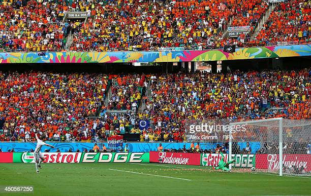 Xabi Alonso of Spain scores a goal from the penalty spot during the 2014 FIFA World Cup Brazil Group B match between Spain and Netherlands at Arena...