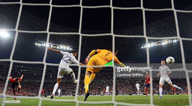 Xabi Alonso of Spain scores the first goal during the UEFA EURO 2012 quarter final match between Spain and France at Donbass Arena on June 23 2012 in...