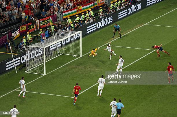 Xabi Alonso of Spain scores the first goal past Hugo Lloris of France during the UEFA EURO 2012 quarter final match between Spain and France at...