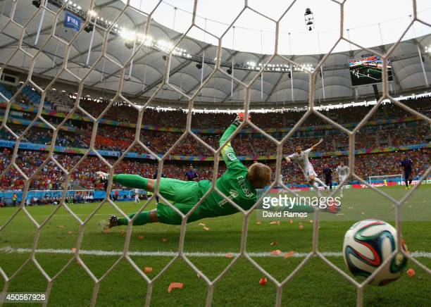 Xabi Alonso of Spain shoots and scores a goal on a penalty kick against goalkeeper Jasper Cillessen of the Netherlands in the first half during the...