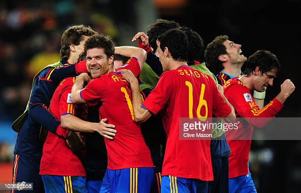 Xabi Alonso of Spain smiles as he celebrates with team mates victory and progress to the final during the 2010 FIFA World Cup South Africa Semi Final...