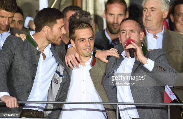 Xabi Alonso Philipp Lahm and Franck Ribery of Bayern Munich celebrate winning the German soccer championship on a balcony of the town hall in Munich...