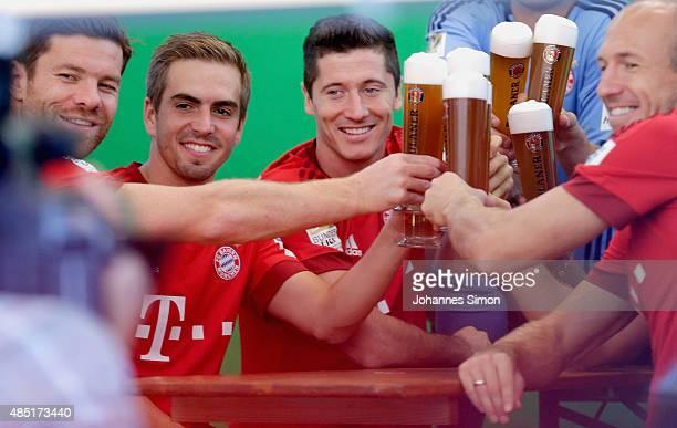 Xabi Alonso Philipp Lahm Robert Lewandowski and Arjen Robben of Bayern Muenchen attend the FC Bayern Muenchen Paulaner photo shoot at Bayern...