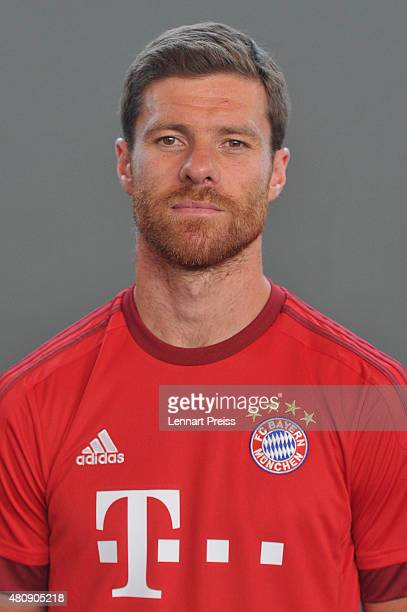 Xabi Alonso poses during the team presentation of FC Bayern Muenchen at Bayern's training ground Saebener Strasse on July 16 2015 in Munich Germany