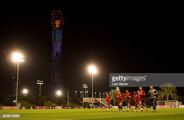 Xabi Alonso warms up with his team mates during a training session at day one of the Bayern Muenchen training camp at Aspire Academy on January 6...