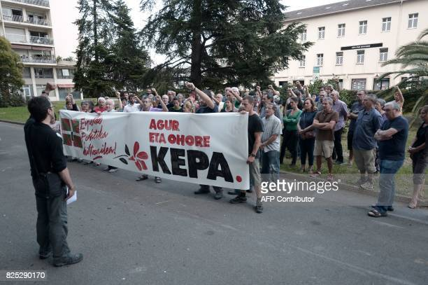 Xabi Larralde spokesperson of the Basque socialist party Sortu raises his fist with others gathered outside the Spanish consulate in Bayonne on...