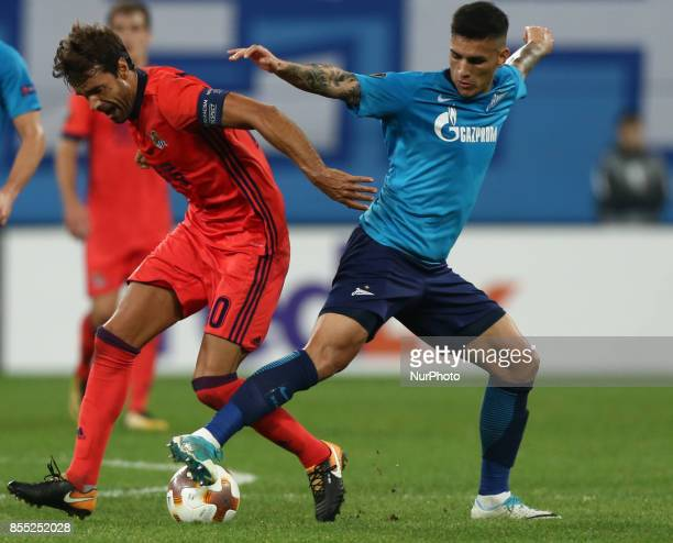 Xabi Prieto of FC Real Sociedad and Leandro Paredes of FC Zenit Saint Petersburg vie for the ball during the UEFA Europa League Group L football...