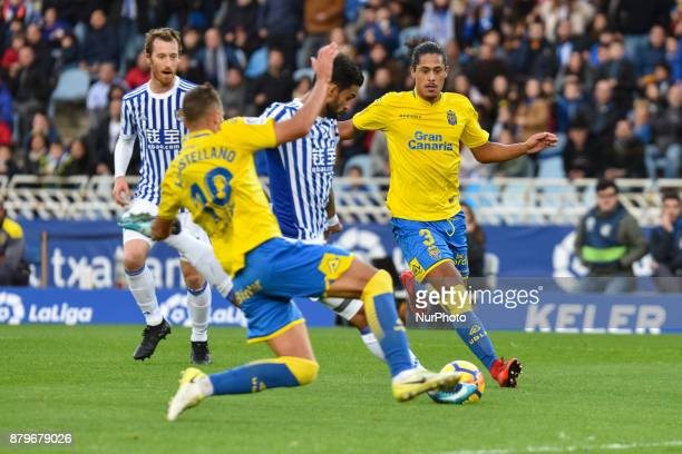 Xabi Prieto of Real Sociedad duels for the ball with Javi Castellano and Lemos of U D Las Palmas during the Spanish league football match between...