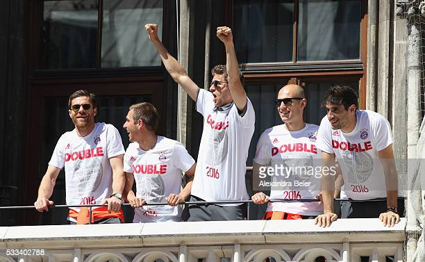 Xabier Alonso Philipp Lahm Thomas Mueller Arjen Robben and Javi Martinez of FC Bayern Muenchen celebrates the team's German Cup and German...