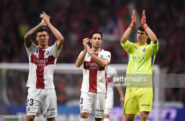 Xabier Etxeita Damian Marcelo Musto and Axel Werner of SD Huesca applaud their fans after going down 30 against Club Atletico de Madrid during the La...