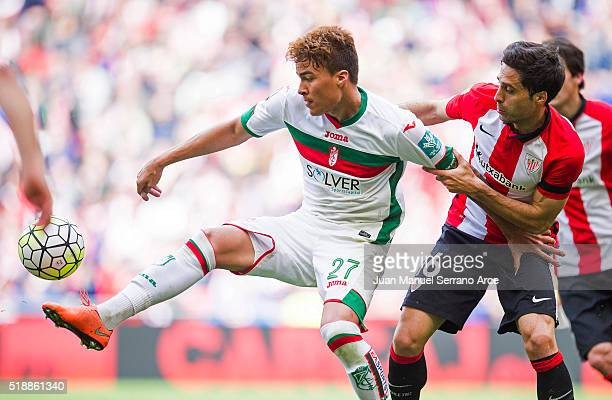 Xabier Etxeita of Athletic Club Bilbao competes for the ball with Adalberto Penaranda of Granada CF during the La Liga match between Athletic Club...