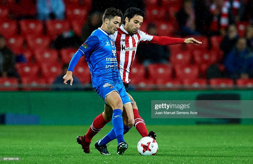 Xabier Etxeita of Athletic Club duels for the ball with Adrian Riera of SD Formentera during the Copa del Rey, Round of 32, Second Leg match between Athletic Club and SD Formentera at San Mames Stadium on November 29, 2017 in Bilbao, Spain.