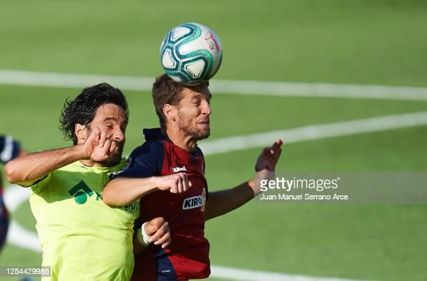 Xabier Etxeita of Getafe CF duels for the ball with Darko Brasanac of CA Osasuna during the Liga match between CA Osasuna and Getafe CF at on July 05...
