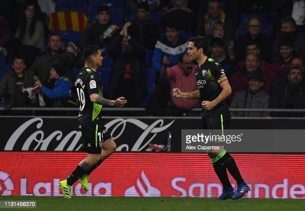 Xabier Etxeita of SD Huesca celebrates scoring with team mate Chimy Avila during the La Liga match between RCD Espanyol and SD Huesca at RCDE Stadium...