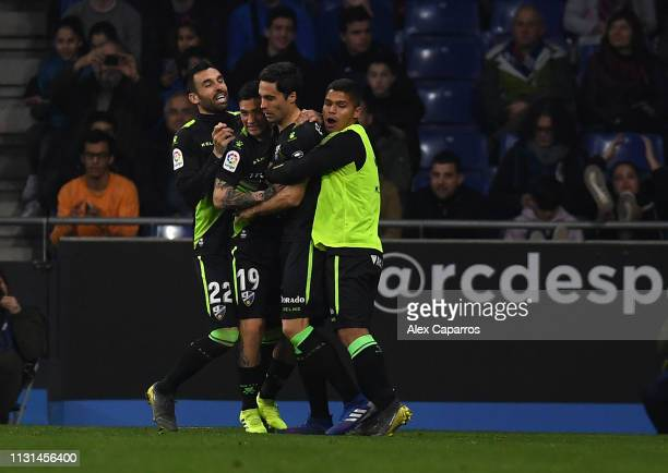 Xabier Etxeita of SD Huesca is congratulated by team mates after scoring during the La Liga match between RCD Espanyol and SD Huesca at RCDE Stadium...