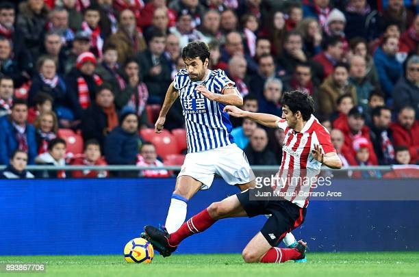 Xabier Prieto of Real Sociedad competes for the ball with Mikel San Jose of Athletic Club during the La Liga match between Athletic Club Bilbao and...