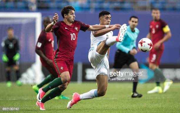 Xadas of Portugal challenges Carlos Benavidez of Uruguay during the FIFA U20 World Cup Korea Republic 2017 Quarter Final match between Portugal and...
