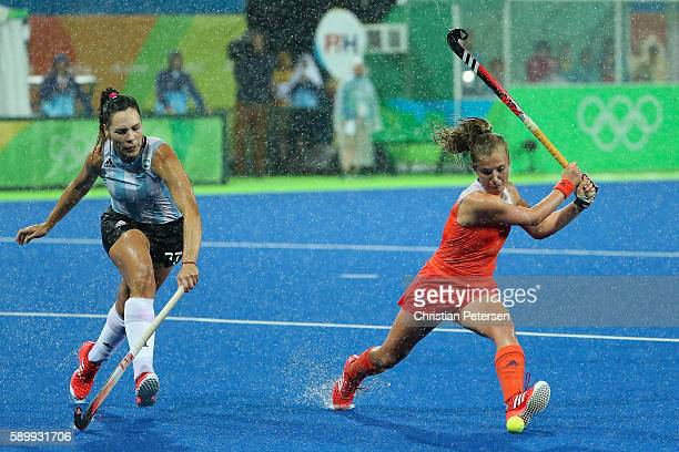 Xan de Waard of Netherlands attempts a shot past Noel Barrionuevo of Argentina during the quarter final hockey game on Day 10 of the Rio 2016 Olympic...
