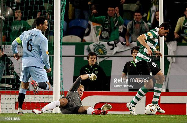 Xandao of Sporting Lisbon scores with a back-heel past Joe Hart of Manchester City during the UEFA Europa League Round of 16 between Manchester City...
