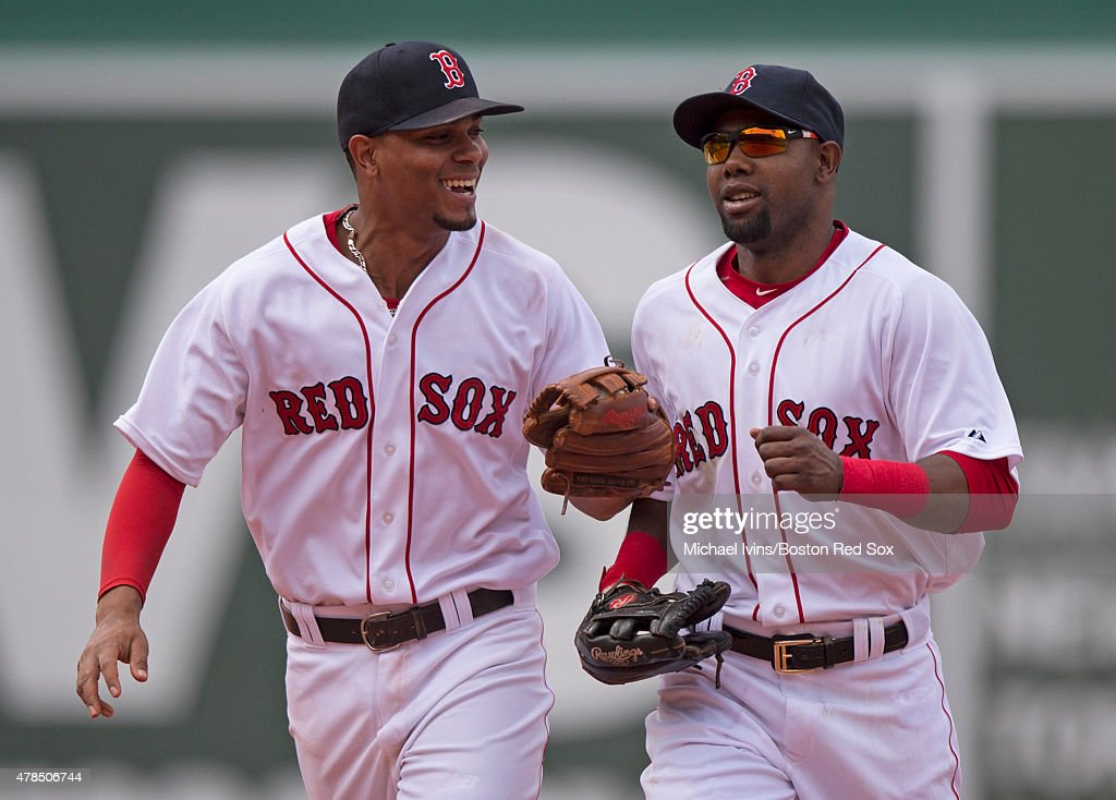 Xander Bogaerts #2 and Alejandro De Aza #31 of the Boston Red Sox head to the dugout in the middle of the sixth inning against the Baltimore Orioles at Fenway Park in Boston, Massachusetts on June 25, 2015.