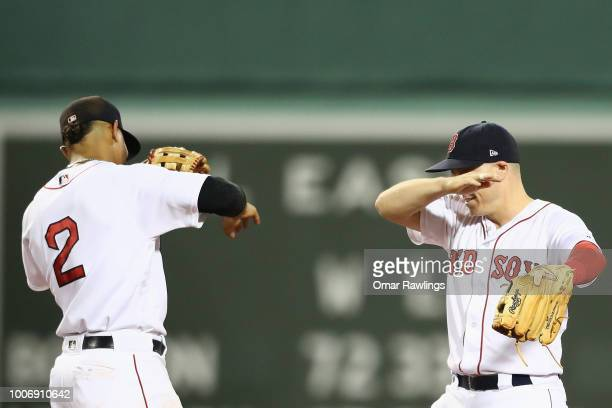 Xander Bogaerts and Brock Holt of the Boston Red Sox celebrates the victory over the Minnesota Twins by dabbing in the outfield at Fenway Park on...