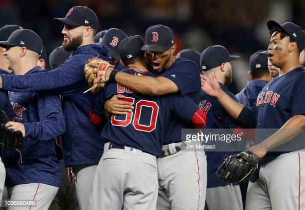 Xander Bogaerts and Mookie Betts of the Boston Red Sox celebrate after defeating the New York Yankees at Yankee Stadium on September 20 2018 in the...
