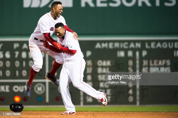 Xander Bogaerts celebrates with Rafael Devers of the Boston Red Sox after Devers hit a walkoff hit against the Toronto Blue Jays at Fenway Park on...