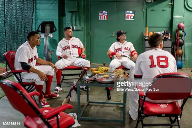 Xander Bogaerts Deven Marrero Andrew Benintendi and Mitch Moreland of the Boston Red Sox sit in the batting cage before a game against the Minnesota...