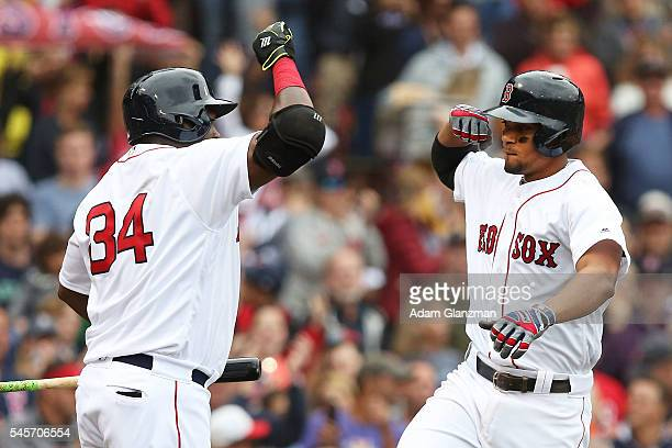 Xander Bogaerts high fives David Ortiz of the Boston Red Sox after hitting a tworun home run in the fourth inning of the game against the Tampa Bay...