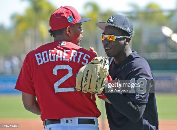 Xander Bogaerts of the Boston Red Sox and Didi Gregorius of the New York Yankees talk prior to a spring training game at JetBlue Park on March 3 2018...
