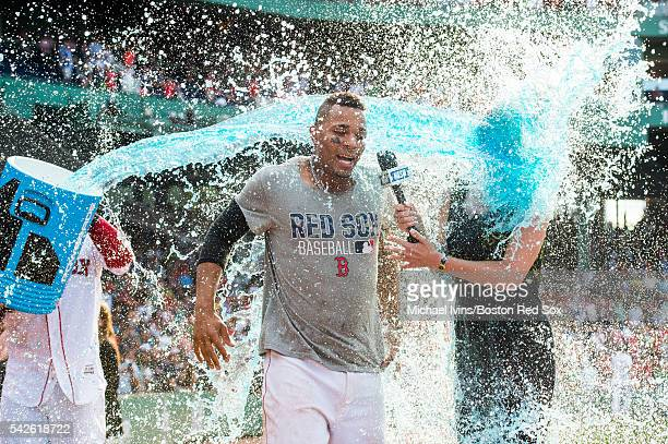 Xander Bogaerts of the Boston Red Sox and NESN reporter Guerin Austin are doused in Powerade after Bogaerts hit a gamewinning single against the...