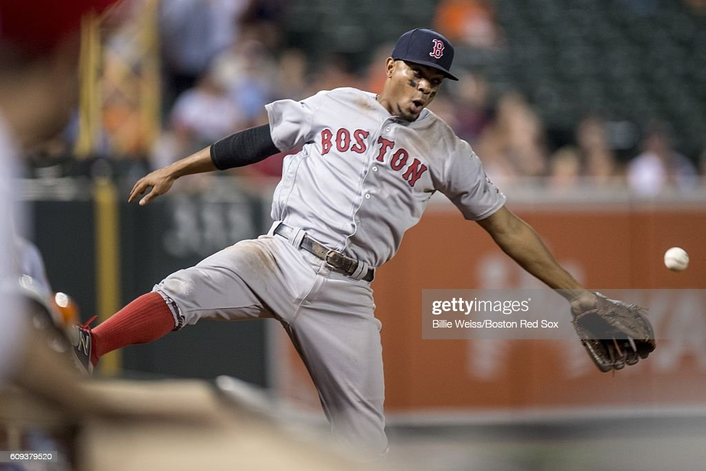 Xander Bogaerts #2 of the Boston Red Sox attempts to catch a fly ball during the ninth inning of a game against the Baltimore Orioles on September 20, 2016 at Oriole Park at Camden Yards in Baltimore, Maryland.
