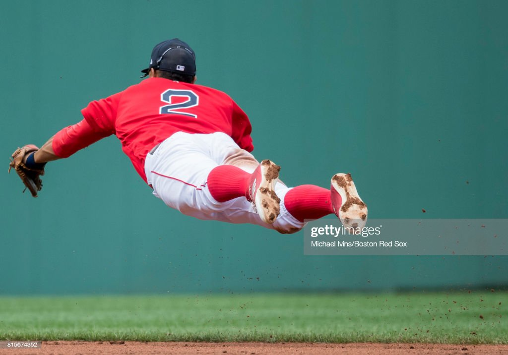 Xander Bogaerts #2 of the Boston Red Sox attempts to field a ground ball against the New York Yankees in the fourth inning of game one of a doubleheader at Fenway Park on July 16, 2017 in Boston, Massachusetts.