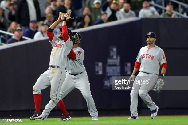 Xander Bogaerts of the Boston Red Sox catches a popup in front of Rafael Denvers during the game between the Boston Red Sox and the New York Yankees...