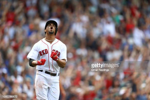 Xander Bogaerts of the Boston Red Sox celebrates after hitting a walkoff​ grand slam in the bottom of the tenth inning of the game against the...