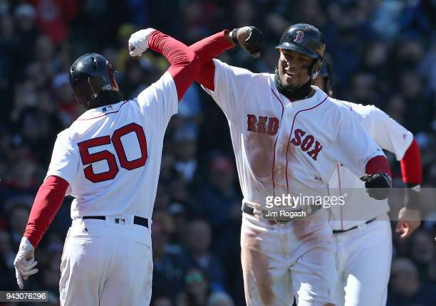 Xander Bogaerts of the Boston Red Sox celebrates his grand slam home run against the Tampa Bay Rays in the second inning at Fenway Park on April 7 in...