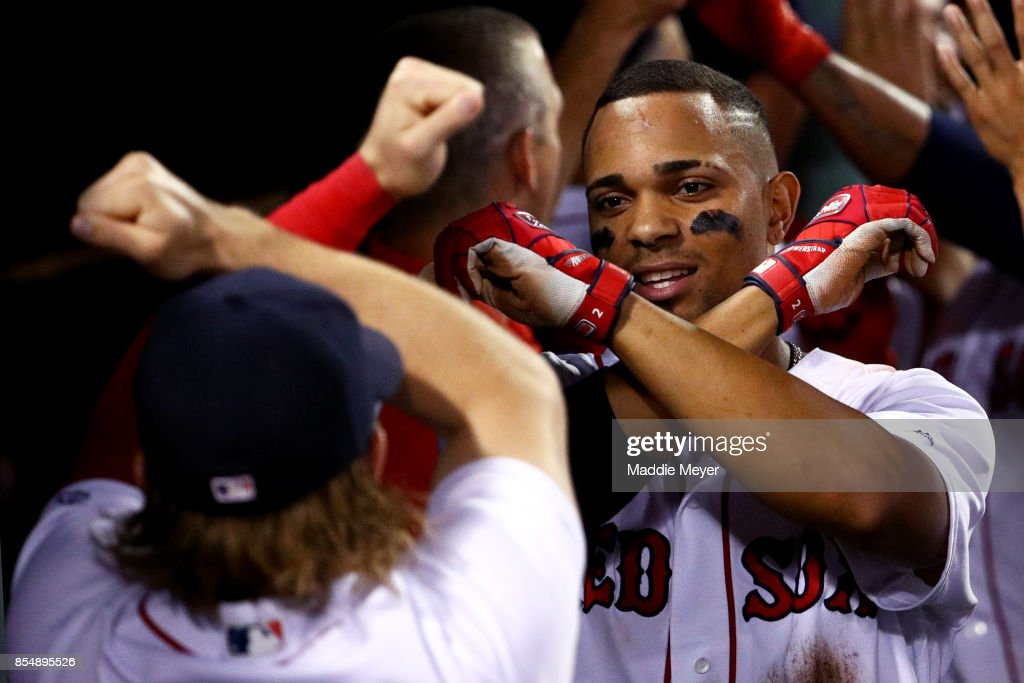 Xander Bogaerts #2 of the Boston Red Sox celebrates with Brock Holt #12 after hitting a three run home run against the Toronto Blue Jays during the third inning at Fenway Park on September 27, 2017 in Boston, Massachusetts.