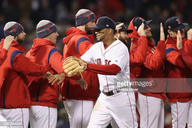 Xander Bogaerts of the Boston Red Sox celebrates with his team after their 84 victory over the Los Angeles Dodgers in Game One of the 2018 World...