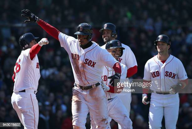 Xander Bogaerts of the Boston Red Sox celebrates with Mookie Betts Andrew Benintendi and JD Martinez after his grand slam home run against the Tampa...