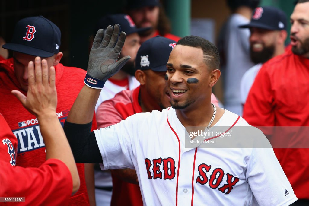 Xander Bogaerts #2 of the Boston Red Sox celebrates with teammates in the dugout after hitting a solo home run in the first inning against the Houston Astros during game four of the American League Division Series at Fenway Park on October 9, 2017 in Boston, Massachusetts.