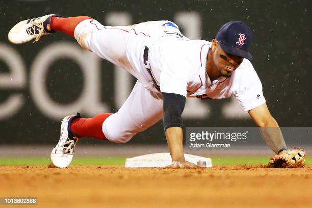 Xander Bogaerts of the Boston Red Sox dives for a ball during a game against the Los Angeles Angels at Fenway Park on June 27, 2018 in Boston,...