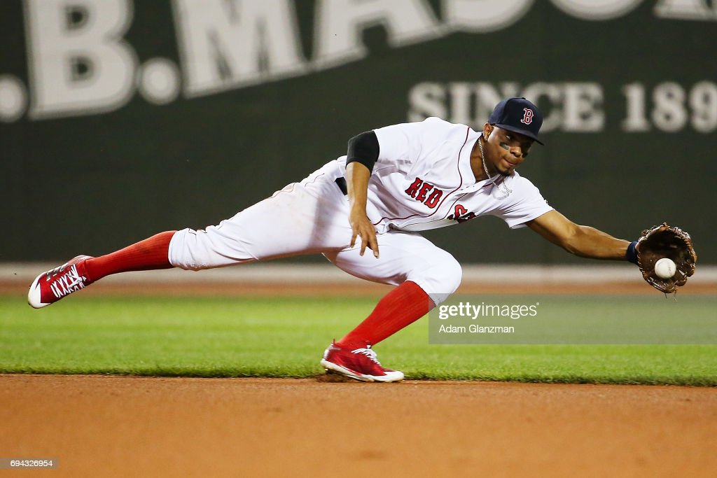 Xander Bogaerts #2 of the Boston Red Sox dives for a ball in the sixth inning of a game against the Detroit Tigers at Fenway Park on June 9, 2017 in Boston, Massachusetts.