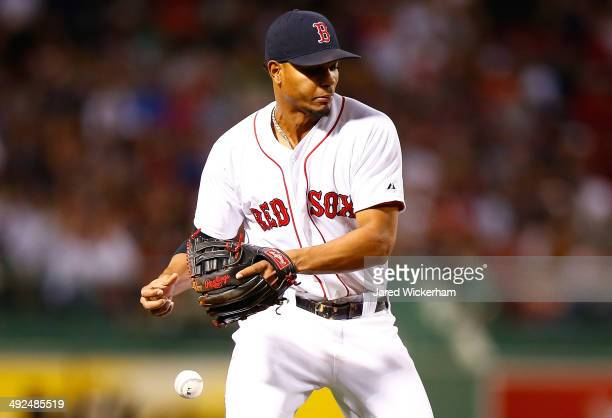 Xander Bogaerts of the Boston Red Sox drops a ground ball in the fifth inning against the Toronto Blue Jays during the game at Fenway Park on May 20...