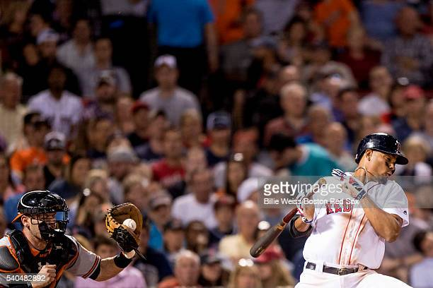 Xander Bogaerts of the Boston Red Sox ducks out of the way of a pitch during the sixth inning of a game against the Baltimore Orioles on June 15 2016...