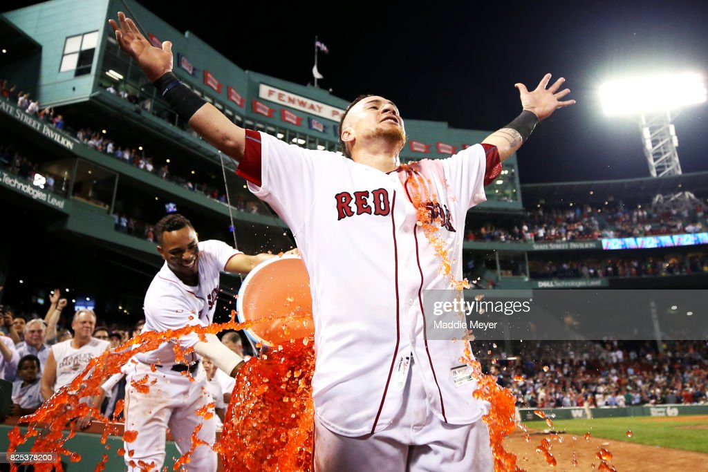 Xander Bogaerts #2 of the Boston Red Sox dunks Christian Vazquez #7 with Powerade after Vazquez hit a three run homer to defeat the Cleveland Indians 12-10 at Fenway Park on August 1, 2017 in Boston, Massachusetts.