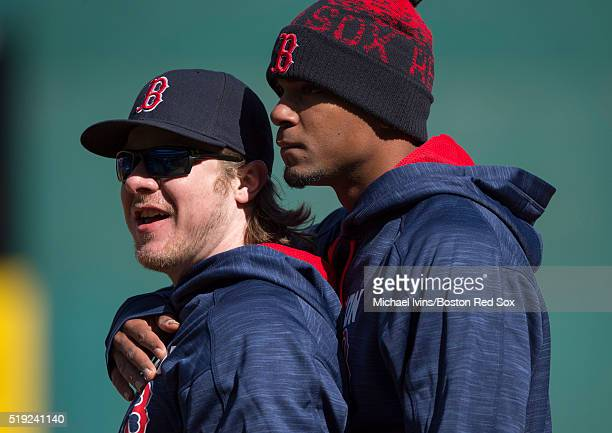 Xander Bogaerts of the Boston Red Sox embraces Ryan Hanigan before an Opening Day game against the Cleveland Indians on April 5 2016 at Progressive...