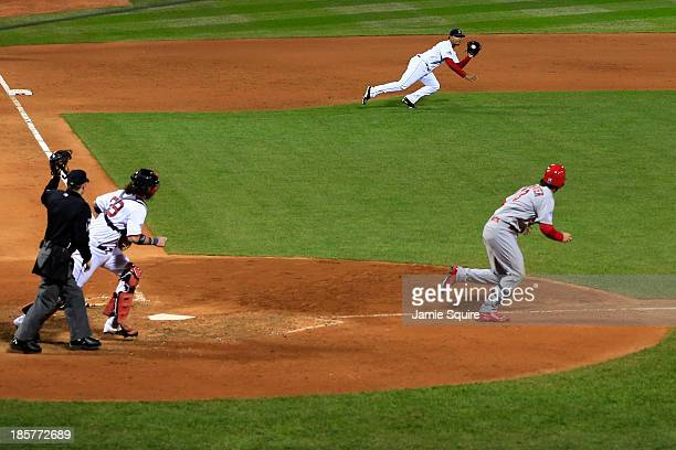 Xander Bogaerts of the Boston Red Sox fields a ball hit by Matt Carpenter of the St Louis Cardinals during Game Two of the 2013 World Series at...