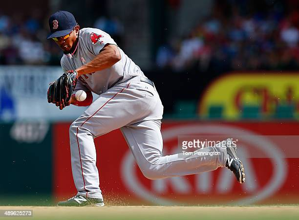 Xander Bogaerts of the Boston Red Sox fields a ground ball hit by JP Arencibia of the Texas Rangers in the bottom of the seventh inning at Globe Life...